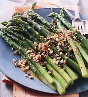 Asparagus with Orange Dressing on a navy plate