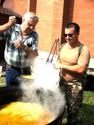 Men stirring the Chicken Booyah