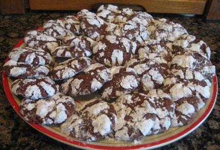 Plate of baked chocolate crinkle cookies.