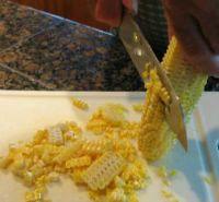 Cutting corn off the cob