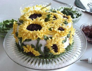 round cake decorated with sunflowers made of icing