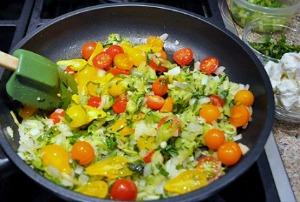 Adding tomatoes to Zucchini Frittata