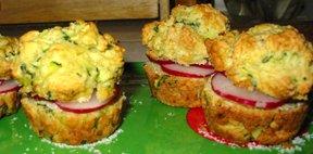 three Radish Muffin Sandwiches on a bright green plate