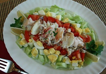 Gourmet Crab Louie Salad served on long white plate