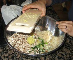 Won Ton Ingredients being added to a mixing bowl