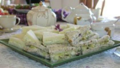 Walnut Tea Sandwich wedges on a square platter at a tea setting