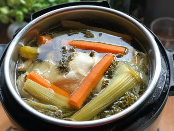 Jewish Chicken Soup-Chicken and Vegetables finished cooking in pressure cooker