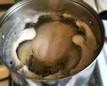 Jewish Chicken Soup-chicken boiling out impurities