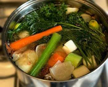 Jewish Chicken Soup-simmering with vegetables and herbs